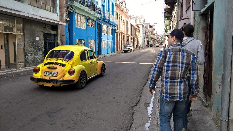 Yellow 1970s Volkswagen bug in Havana, Cuba.