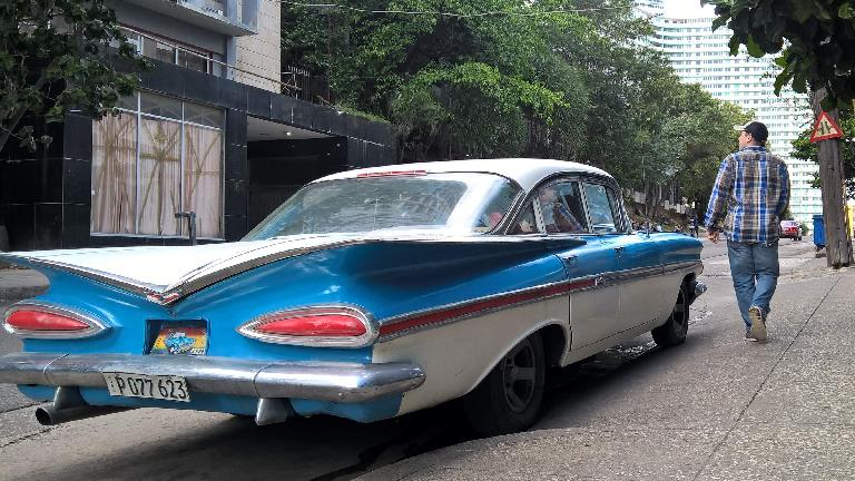 Two-tone aqua/white 1959 Chevrolet Impala four-door sedan in Havana, Cuba.