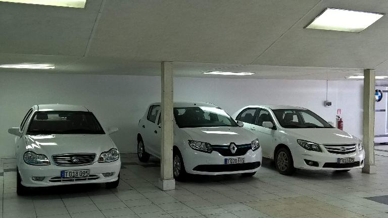 Rental cars available in Havana, Cuba: white Geely, Renault, and BYD.