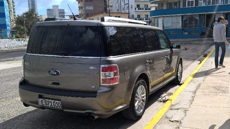 A grey Ford Flex in front of the U.S. Embassy in Havana, Cuba.