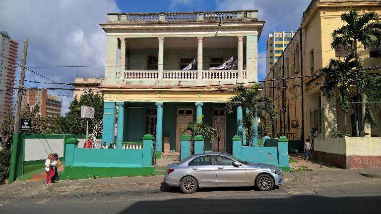 A newish Mercedes C-Class sedan in Havana, Cuba.