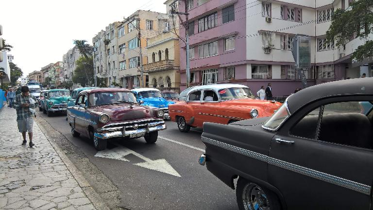 Several almendrones (pre-revolutionary cars as taxis) can be seen here in Havana, Cuba.