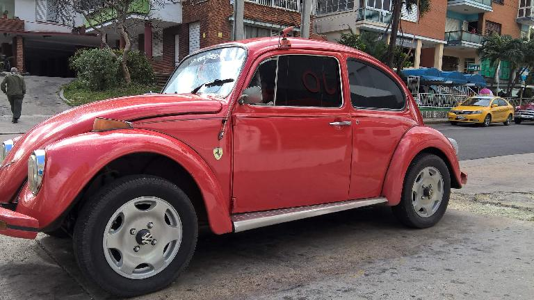 A red Volkswagen Bug with a Ferrari decal in Havana, Cuba.