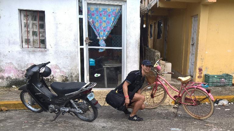 black Honda Wave motorbike, Felix Wong, pink Huffy Panama Jack cruiser bike