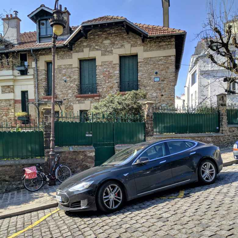 A black Tesla Model S in Montmartre.