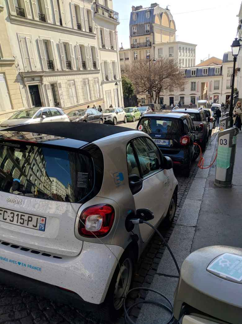 Electric Smart cars being charged in Montmartre.