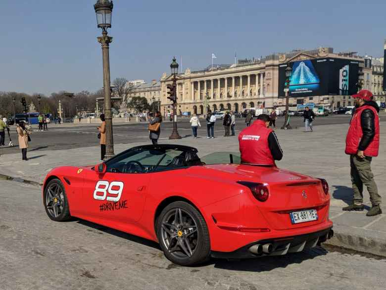 A red Ferrari California being rented near the Louvre for 129 euros for a 20-minute drive.