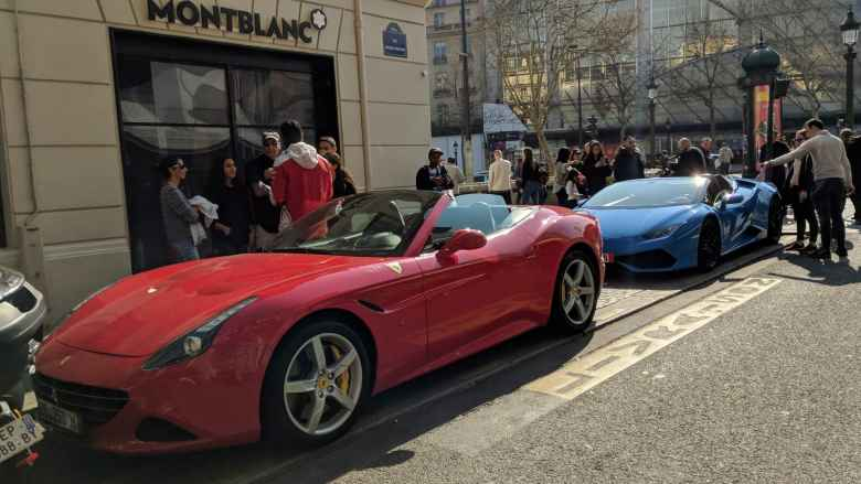 A red Ferrari California and a blue Lamborghini Huracán convertible near the Champs-Élysées were available for rent for about 100 euros for 30 minutes.