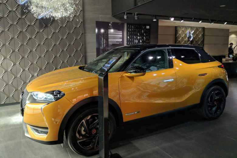 A yellow DS 3 Crossback inside the the DS Automobiles showroom on Rue François 1er.