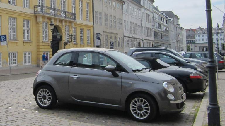 Fiat 500 (and a Porsche Boxster behind it) in Copenhagen.