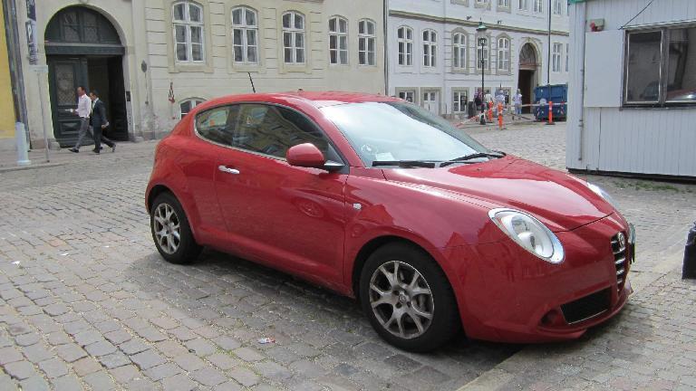 A red Alfa Romeo MiTo in Copenhagen.