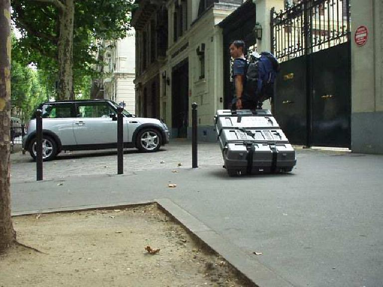 """While lugging my bike box to L'Hotel de l'Alma in the 7th arrondissement in Paris, I encountered a New Mini.  There were also many of the """"old"""" (original) Minis, including some with airbags!"""