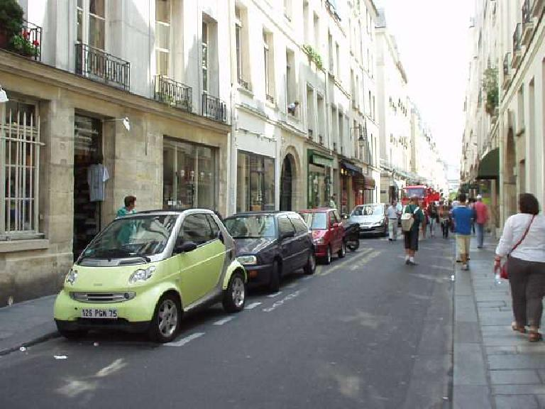 Environmentally-conscious, space-efficient hatchbacks are big in Europe.  Here is a Smart vehicle (in yellow/green), followed by a Renault Clio (I think?), a Fiat Punto (in red), a motorcycle, and a Peugeot 206 in the 7th arrondissement in Paris. (August 15, 2003)