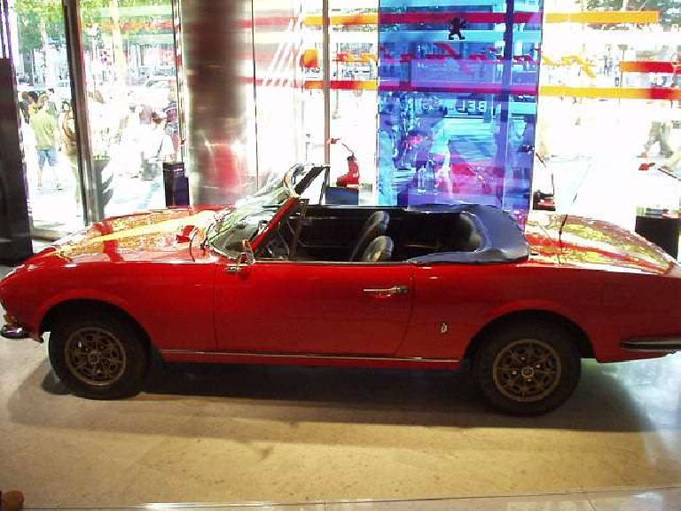 In Peugeot's Champs Elysees showroom was dedicated to its Pininfarina-styled cars.  This particularly Peugeot looked just like a lengthened Fiat Spider, which is not too surprising considering Pininfarina penned that too! (August 24, 2003)