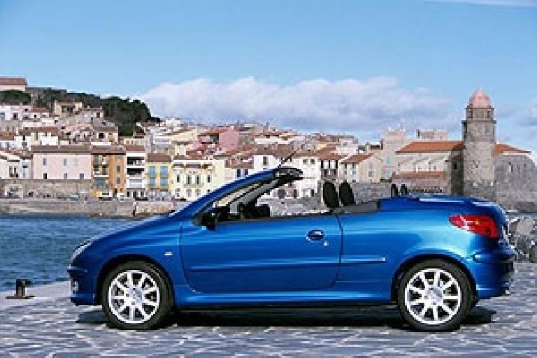 The Peugeot 206CC is a nifty hardtop-retracting convertible. Too bad we don't get any of these beautiful, personality-laden cars in the states! (From the peugeot.com website.) (August 24, 2003)