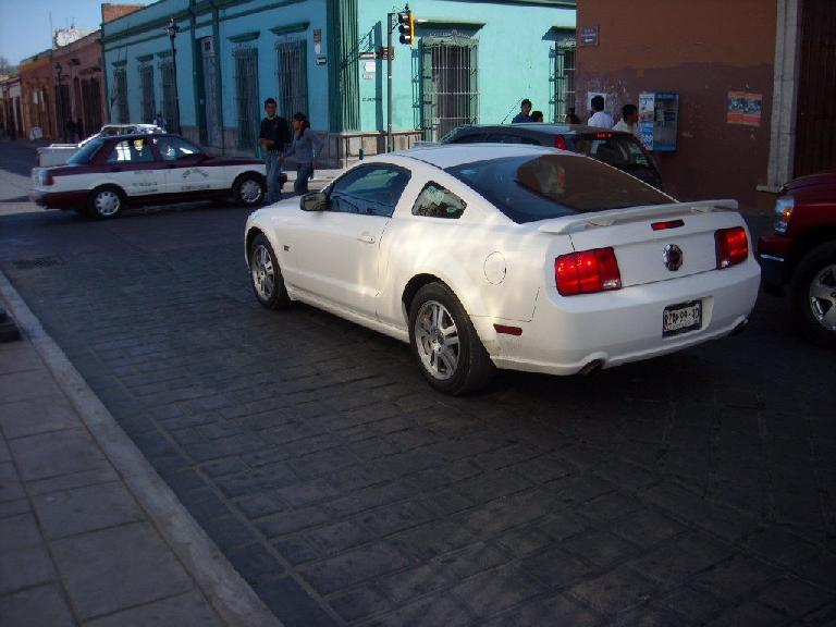 I saw three Ford Mustangs -- one from the 90s, and two from 2008 or so including this white one. I also saw a billboard advertising the new Camaro so Mexico must get that too.
