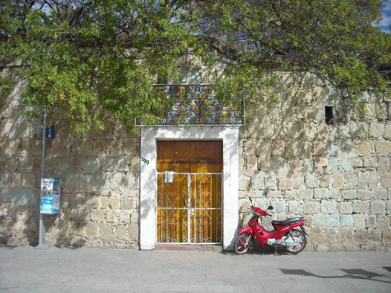 A red scooter outside the Instituto de Artes Graficas in Oaxaca. (December 17, 2009)