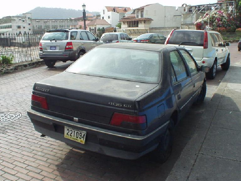A late 80s or early 90s Peugeot 405 sedan in the French Quarter. (March 11, 2007)