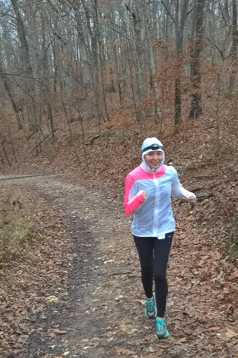 Maureen running up a steep hill at Castlewood State Park.