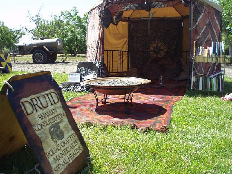 "Elsewhere at the festival was this Druid Shaman Consultations tent that advertised ""poems crafted, manticarts, and spinal healing."""