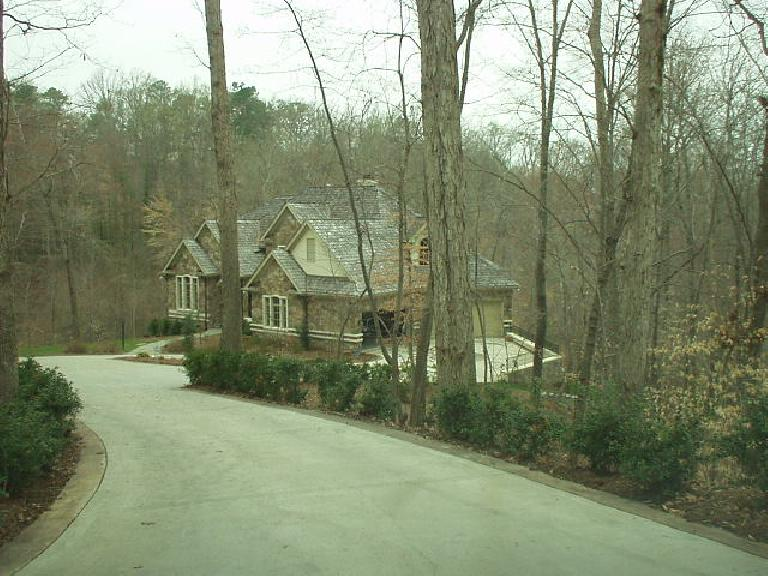 Two miles north of downtown were large classic homes in the woods.