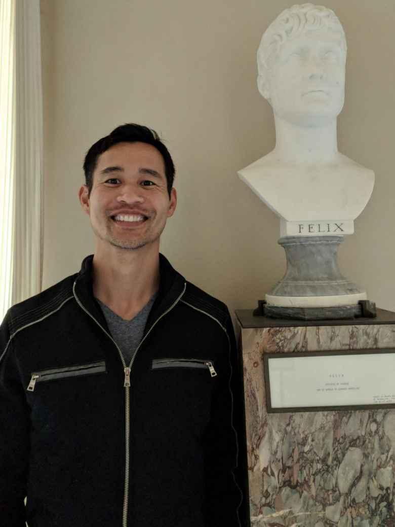 Felix Wong with a Felix statue inside the Château de Fontainbleau.