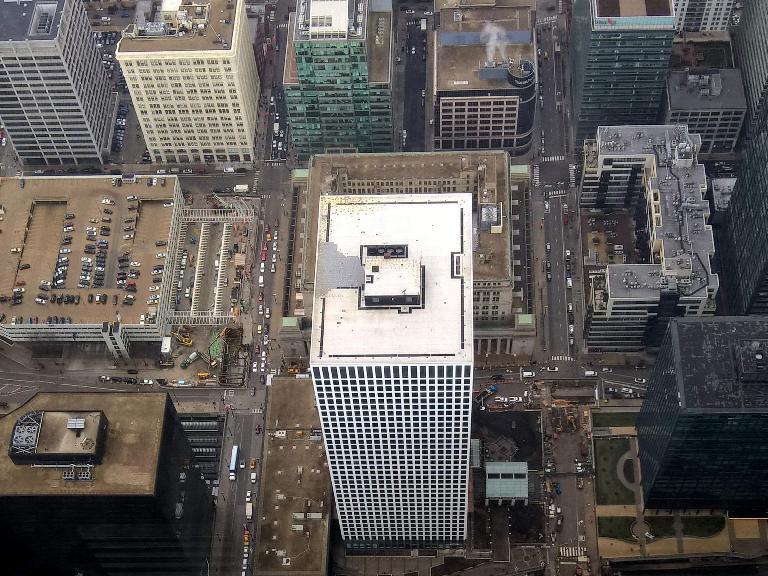 View of a white skyscraper from the top of Willis Tower. (April 7, 2016)