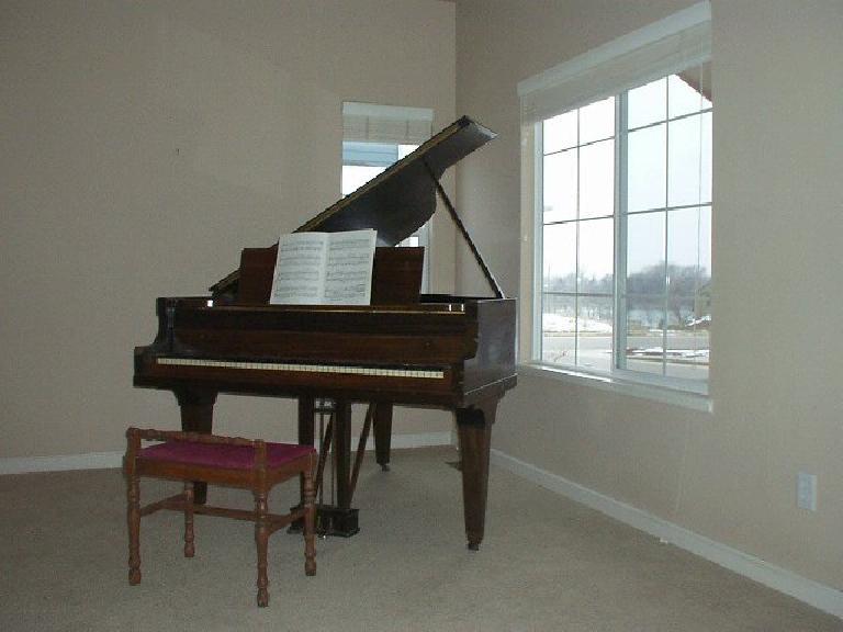 My pre-Depression era Chicago Cable Company piano.