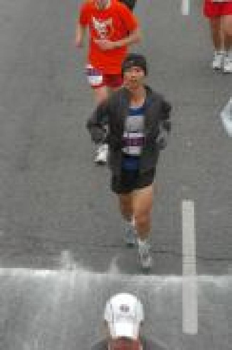 Felix Wong about to cross the finish line.  I had unzipped my jacket moments earlier just so my race number would show. Photo: marathonfoto.com.
