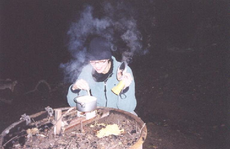 """Tending to our angel hair pasta for dinner. If you must know, the pasta on the fire pit outside of the pot was due to Sarah's little """"pasta accident""""!"""