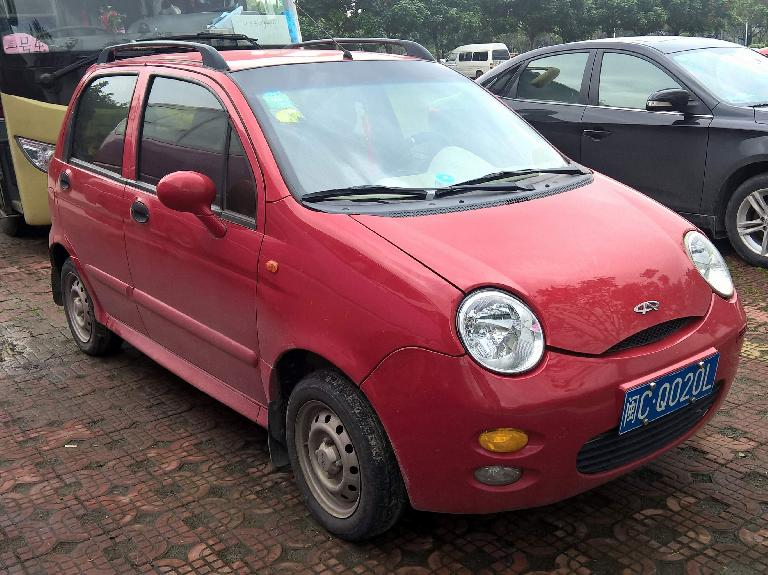 A red Geely QQ, a clone of the Chevy Spark/Daewoo Matiz. (April 16, 2016)