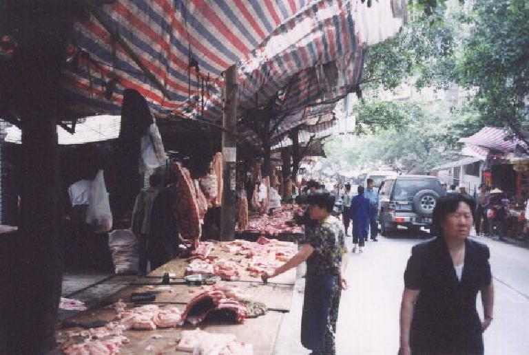 An outdoor meat market among the many food stalls.