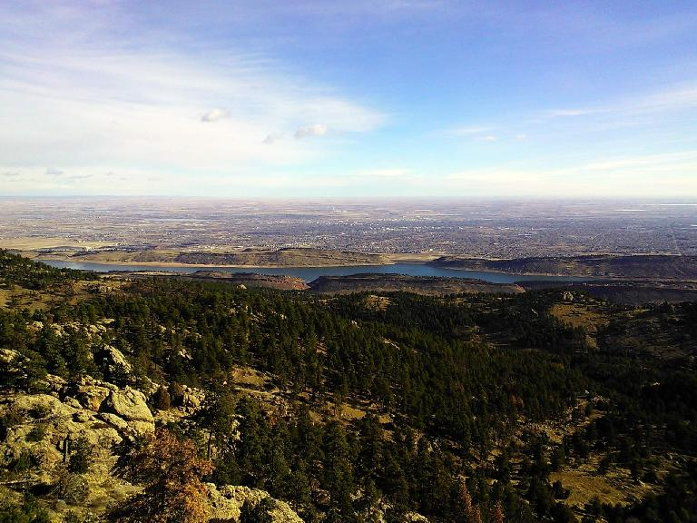 The view of Horsetooth Mountain Park, Horsetooth Reservoir, and Fort Collins beyond.