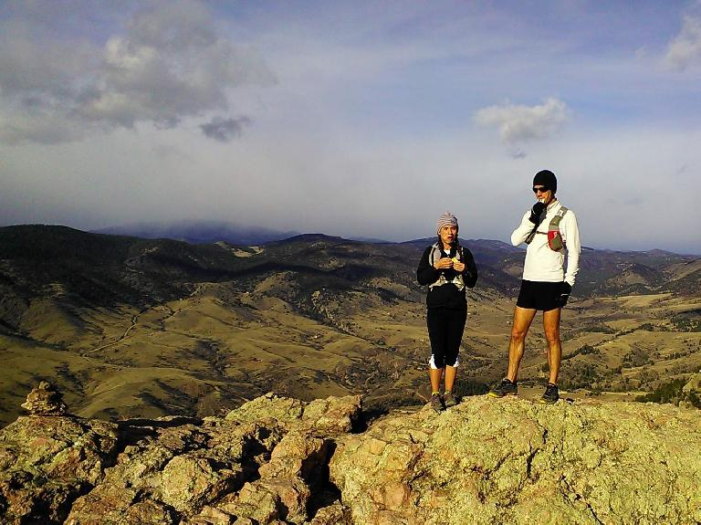 [Mile 3.5] Victoria and another runner at the top of Horsetooth Rock taking a quick food break.