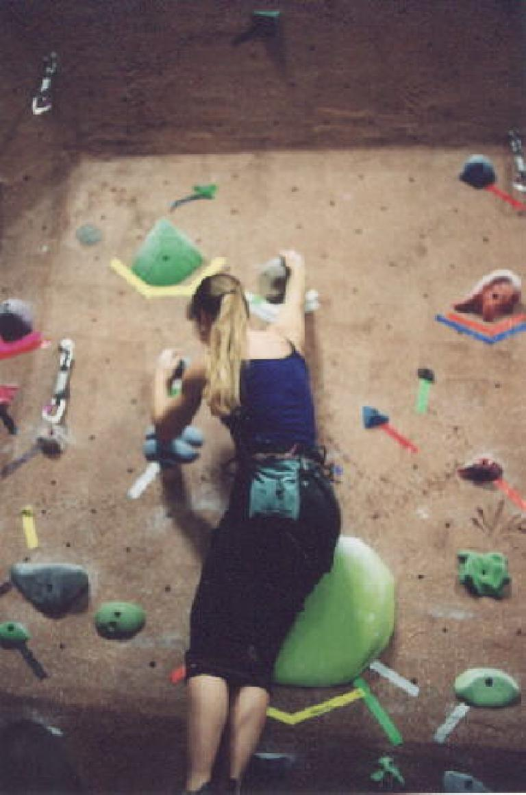 Sharon making it to the top of the boulder problem!