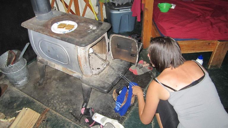 Diana roasting some marshmallows.