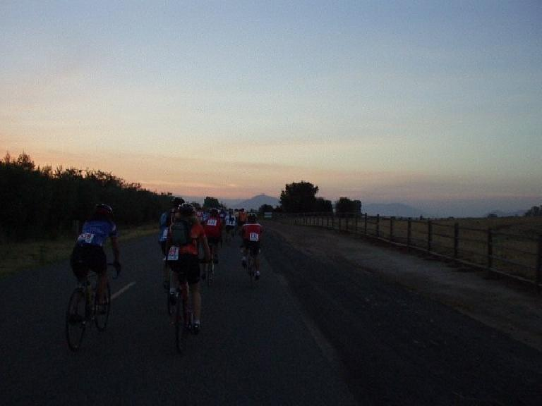 [Mile 10, 6:04 a.m.] During the first 15 miles, which were actually flat, all of us 200 cyclists rode in packs, enjoying a nice sunrise.