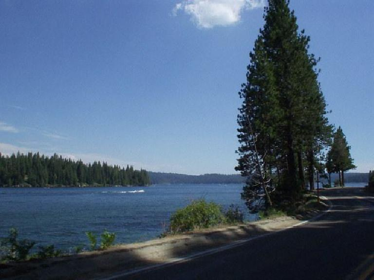 [Mile 99, 3:40pm] Passing by Shaver Lake again, a popular site for fisherman and motorboat people.