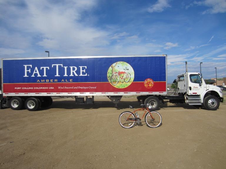 [Day 1, Mile ~40, 9:13a] In front of a New Belgium Fat Tire truck.