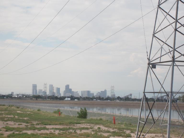 [Day 1, Mile 63, 11:11 a.m.] Skycrapers from Denver's downtown in the distance.