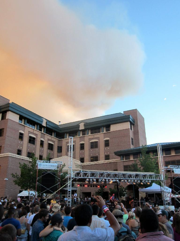 "The smoke cloud above from the High Park Fire looked like it had a smiley face while Matt Kearney sang his encore of ""Dawn."" (June 10, 2012)"