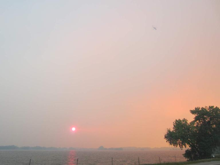 You can see one of the planes that was used to fetch and dump water on the fire. (June 10, 2012)