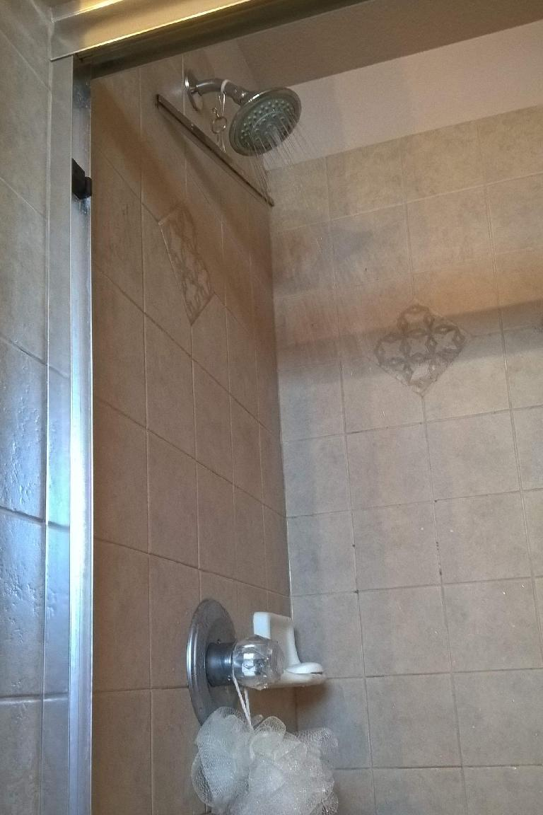 brown tile shower, cold water