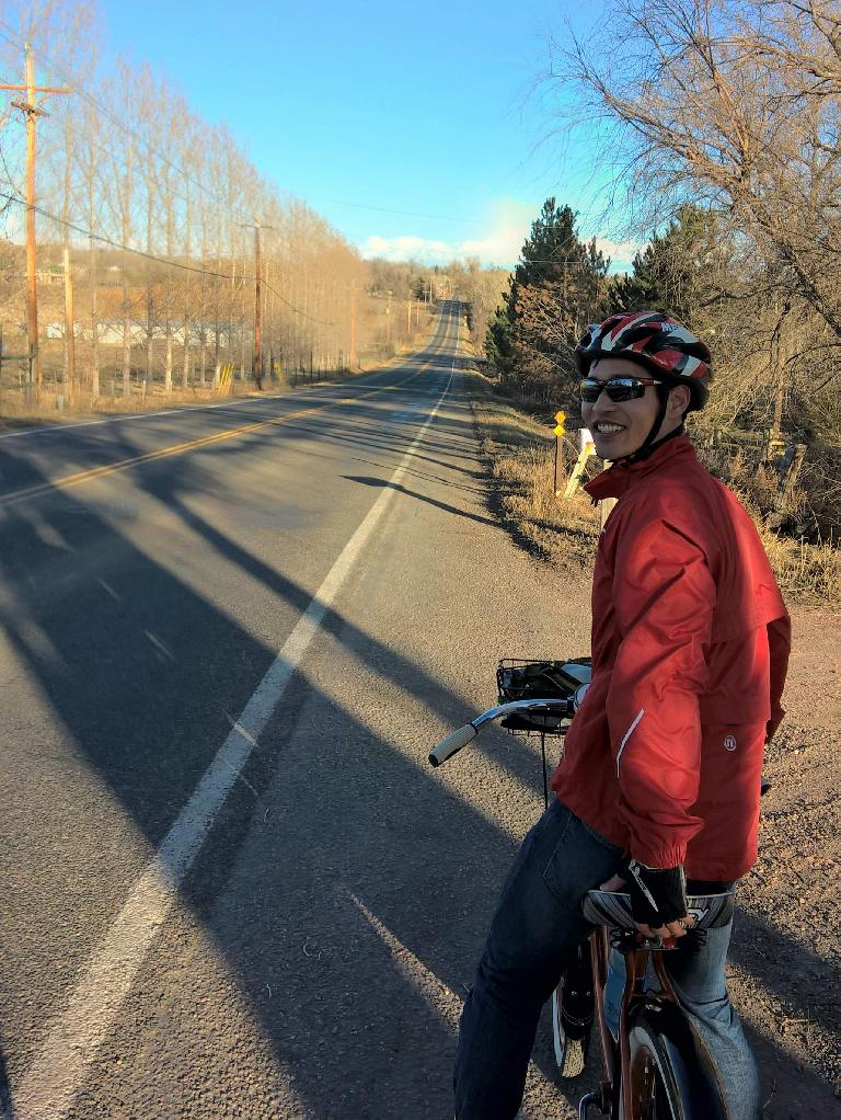 Felix Wong, red jacket, Huffy cruiser, Douglas Rd., Fort Collins