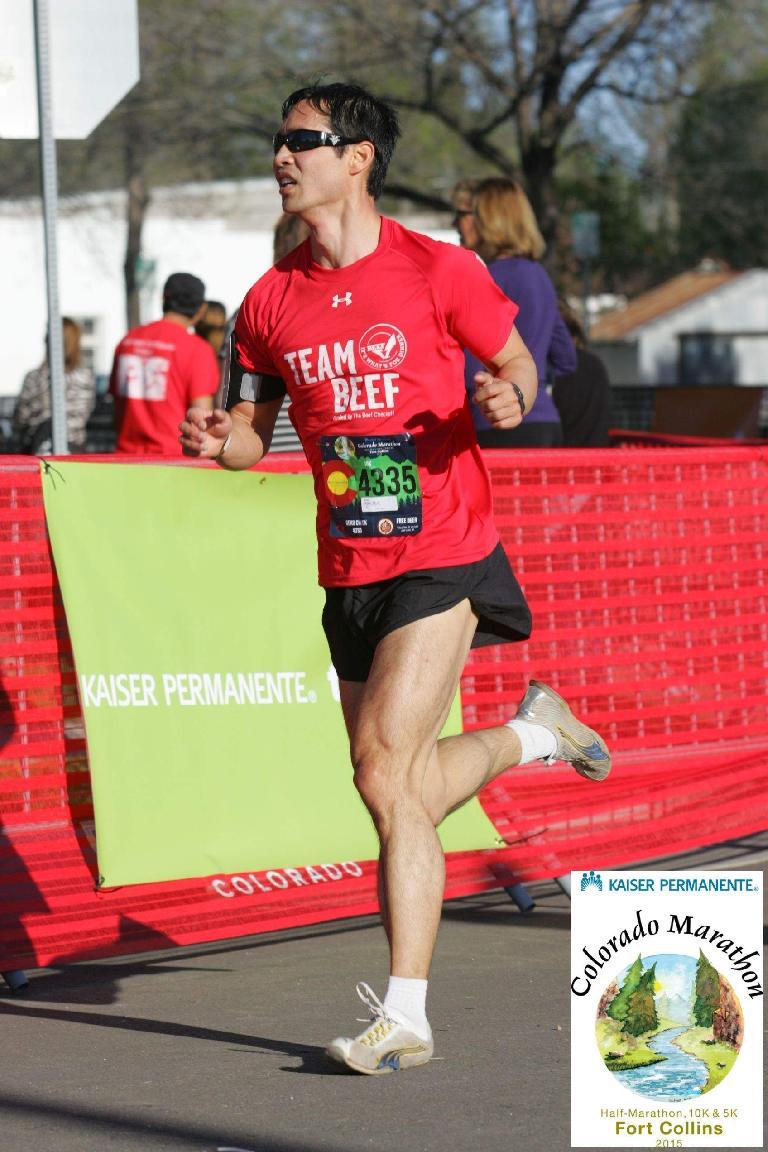 Felix Wong rounding the corner of the Colorado Marathon 10k, , red shirt, Team Beef