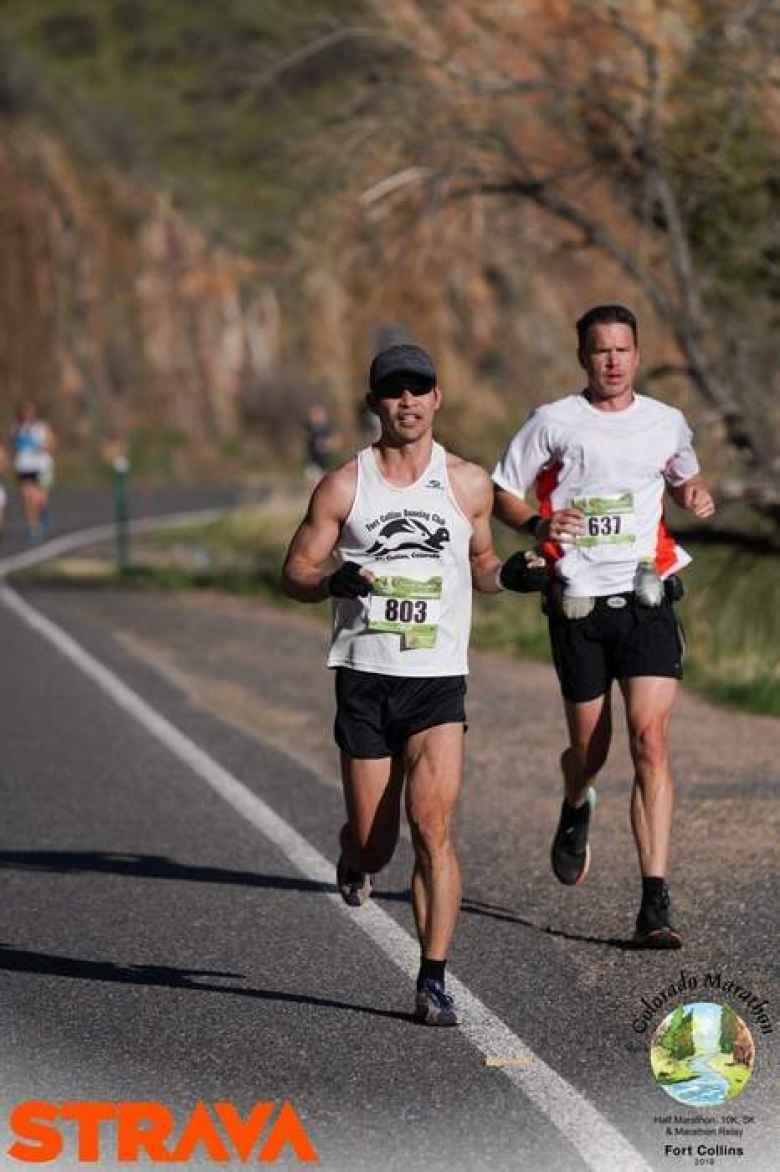 Felix Wong running down the Poudre Canyon in the 2019 Colorado Marathon.