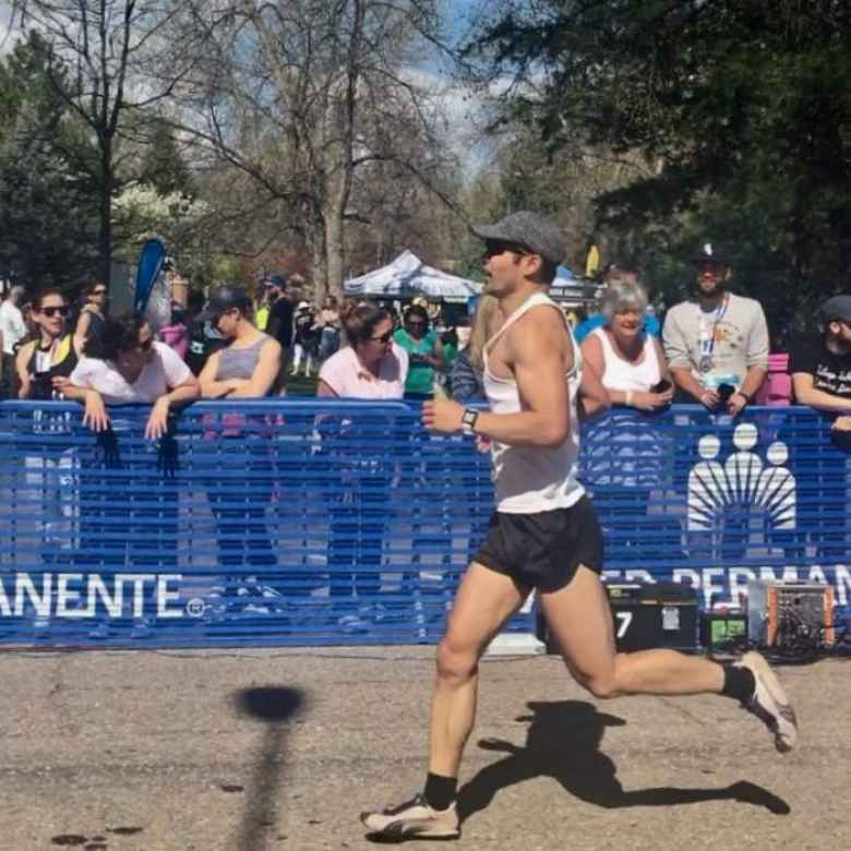 Felix Wong sprinting into the finishing chute of the 2019 Colorado Marathon.