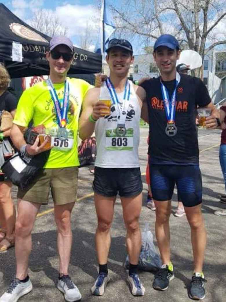 Carl, Felix, and Antxon with celebratory beers from Odell Brewing Company after finishing the 2019 Colorado Marathon.