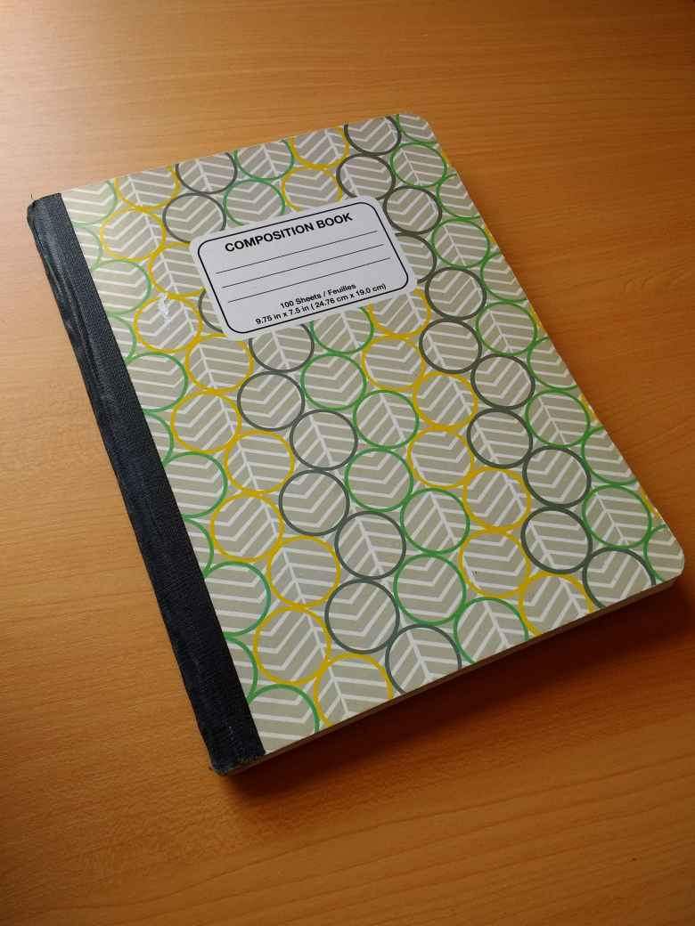 composition book, rings on cover