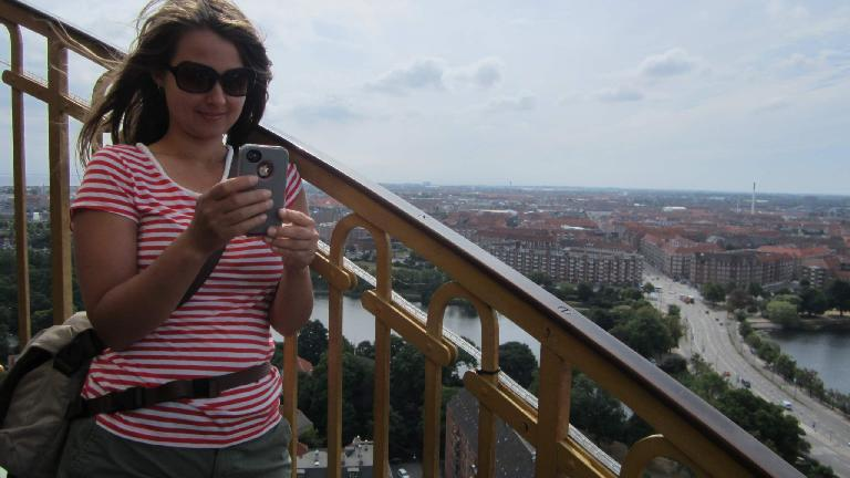 Katia taking a picture from the top of the Savior's Church.